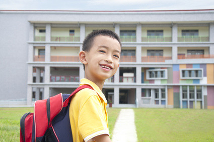 Asian kid happy to go to school